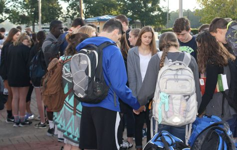 Students pray at the pole