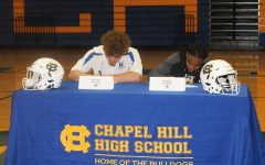 Football players sign scholarships