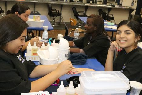 Cosmetology polishes their look