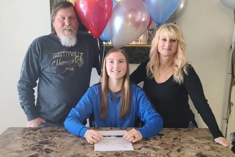 Clark signs to play college soccer