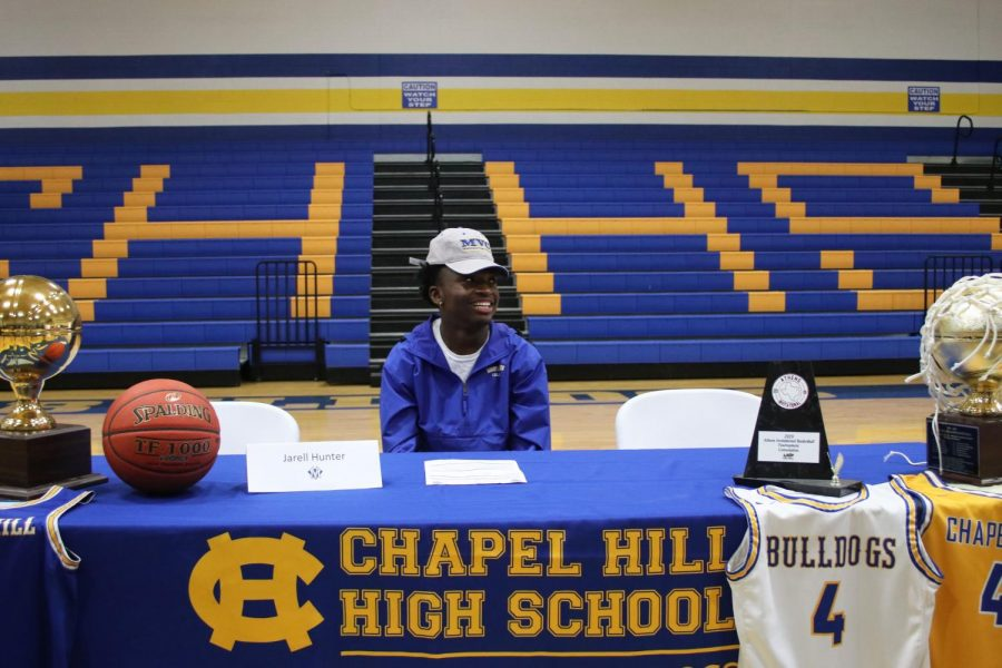 Hunter signs to play college basketball
